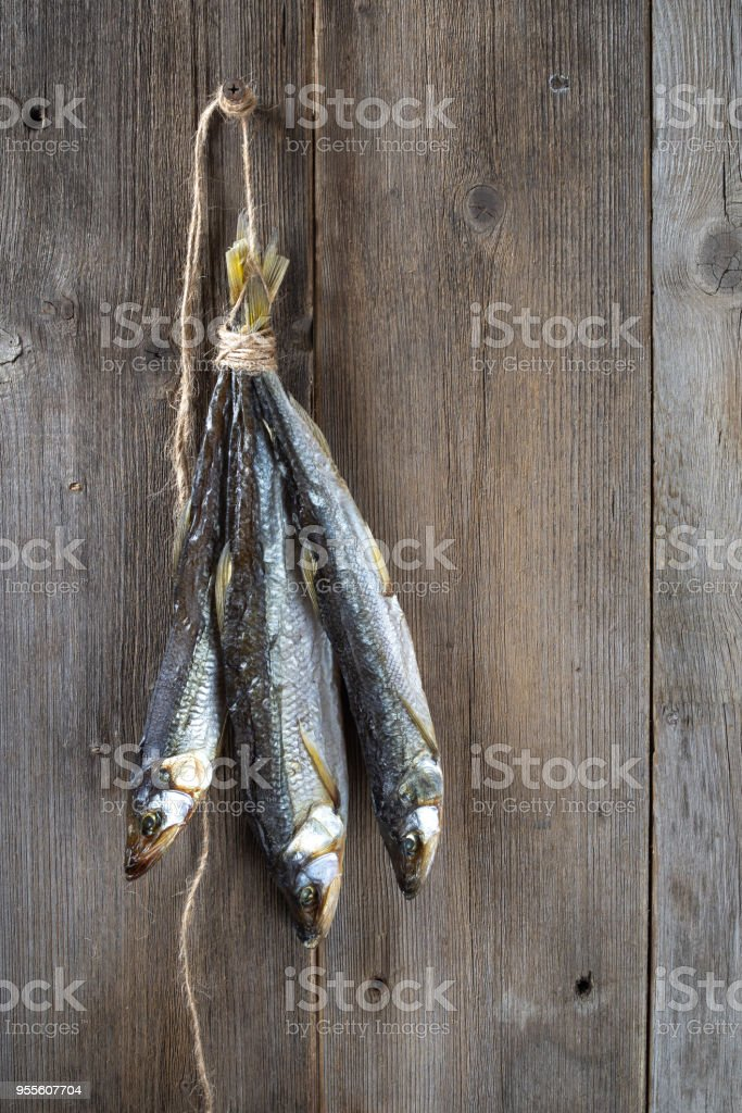 Dried fish on wooden boards stock photo