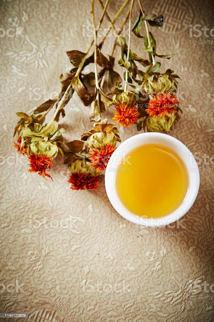 Dried orange flower with cup of tea