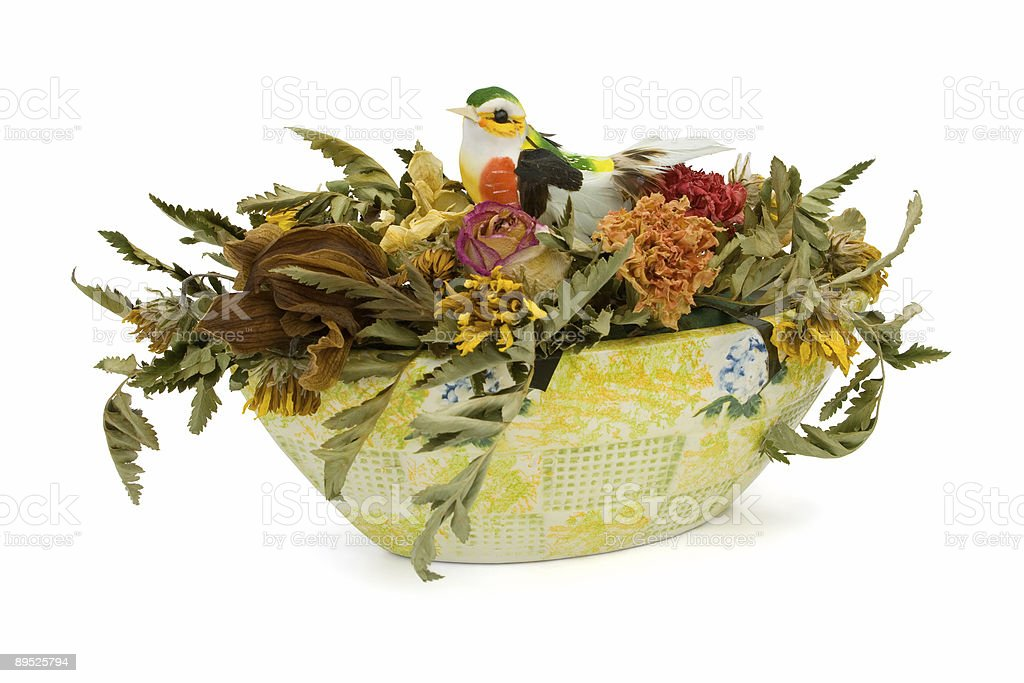 Dried flowers and bird in vase royalty-free stock photo