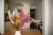 Dried flowers arrangement in a vase inside a house