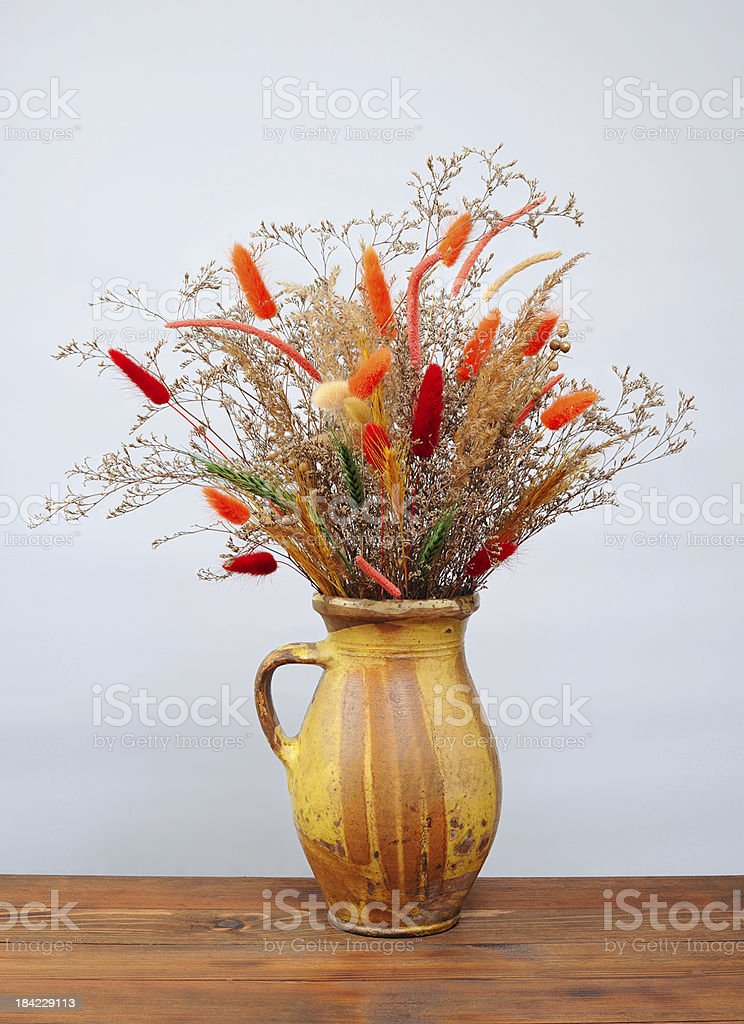 Dried flowers in a ceramic vase royalty-free stock photo