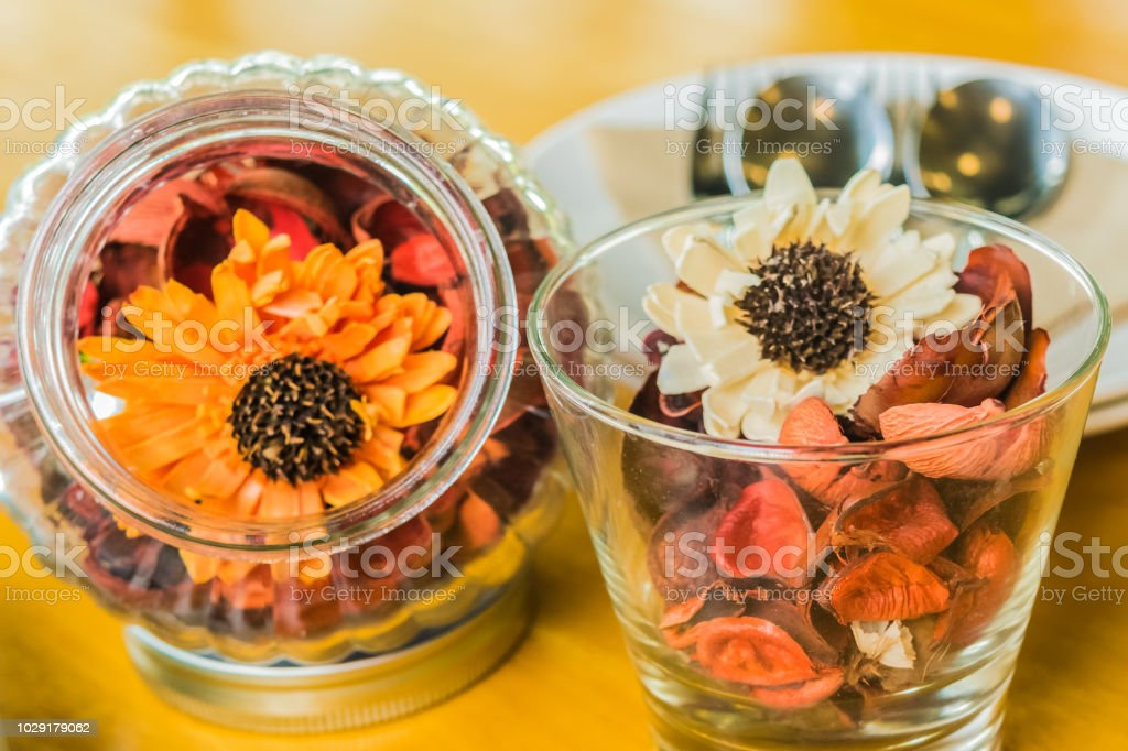 Dried flowers in glass jar Put on the table The atmosphere is good...