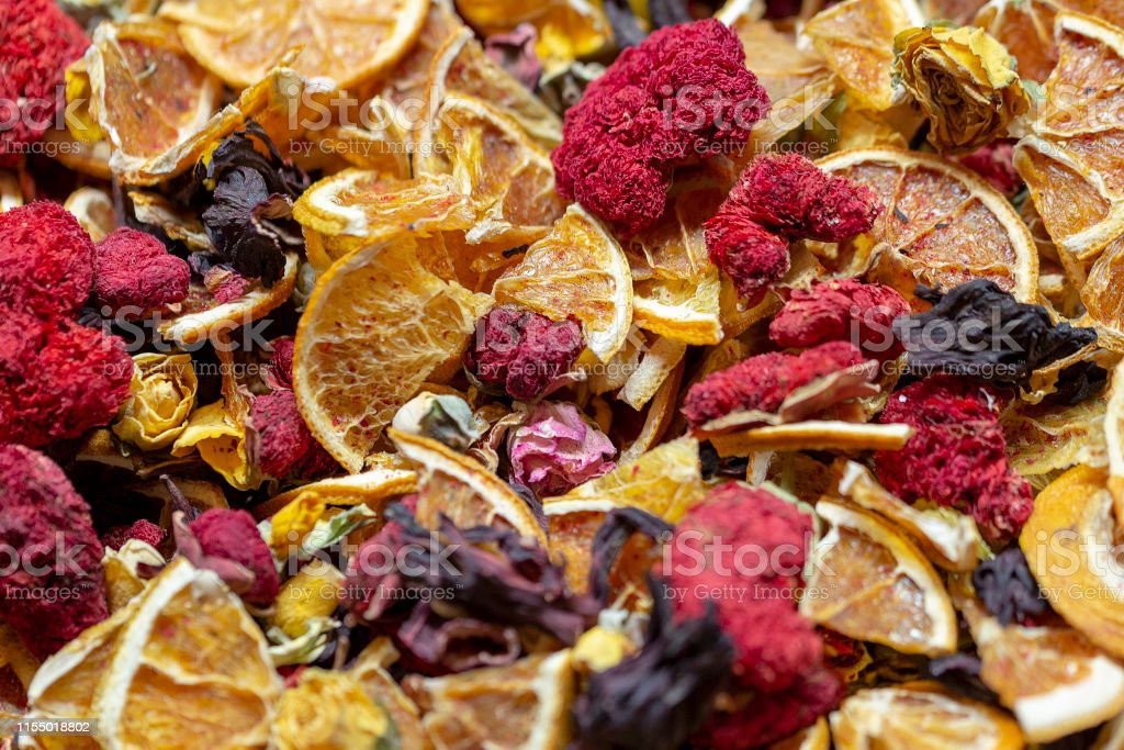 Dried flowers of pomegranate and orange. Closeup picture