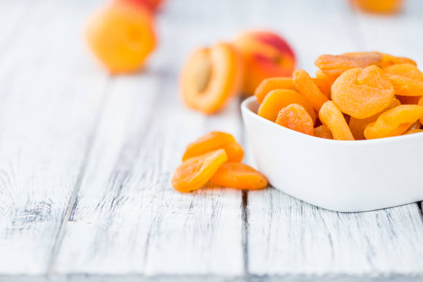Dried Food (Apricots) (selective focus, close-up shot) stock photo