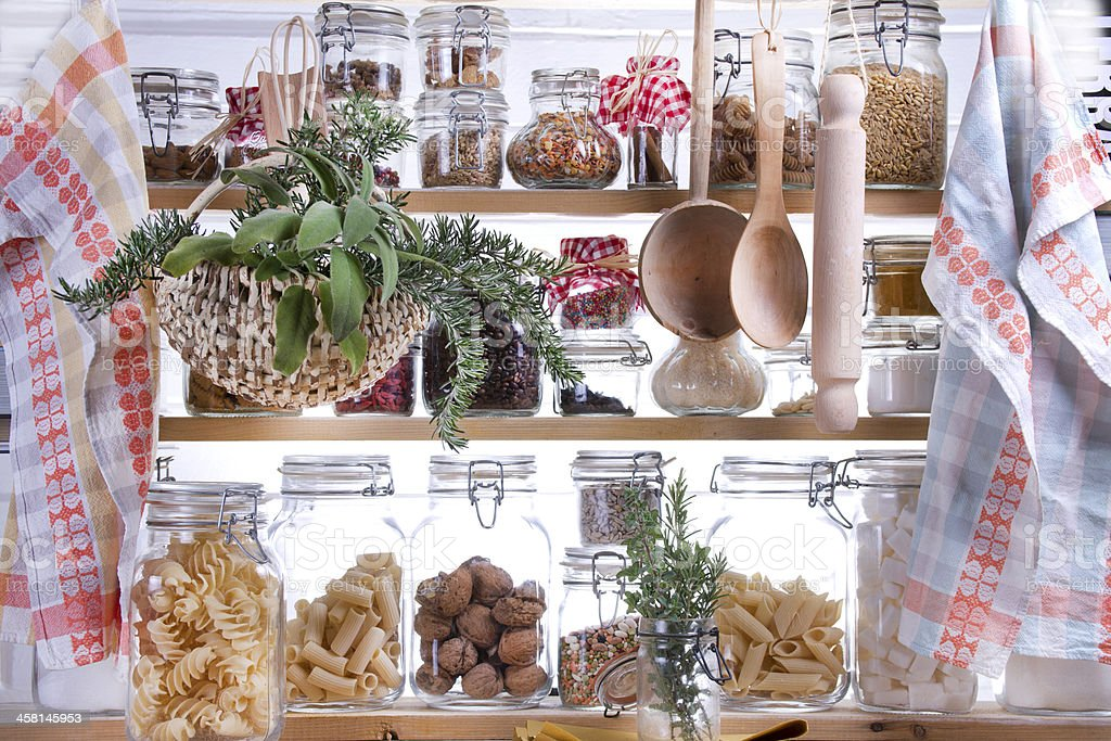 Dried foods stored in glass jars within a small pantry stock photo
