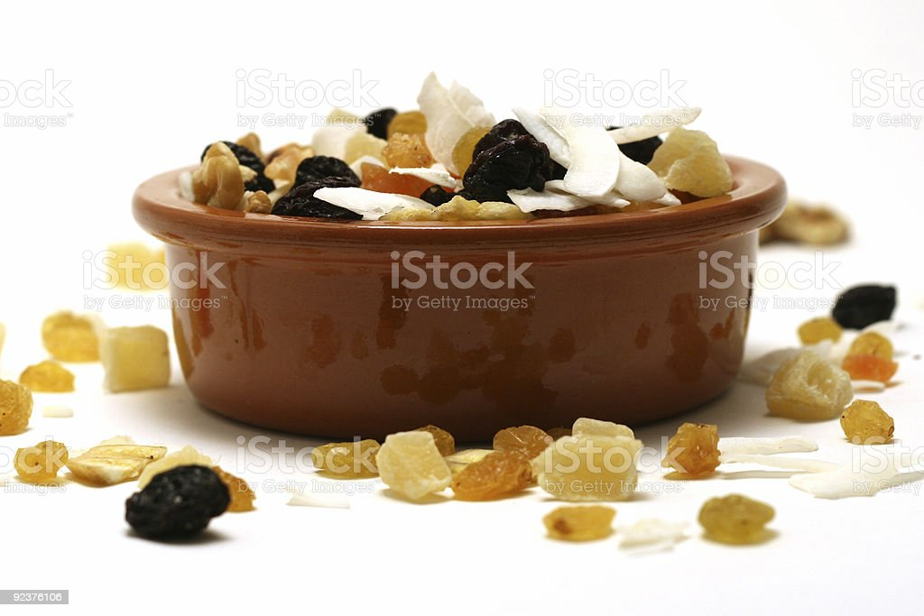 Dried fruit and nuts in a bowl - white background royalty-free stock photo