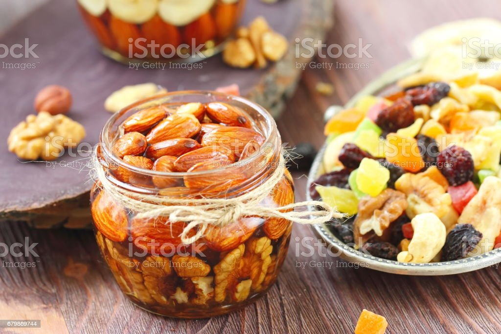 Dried fruit and nuts in honey stock photo