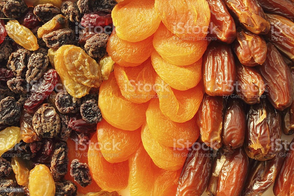 Dried fruit assortment of dates, raisins and apricots royalty-free stock photo