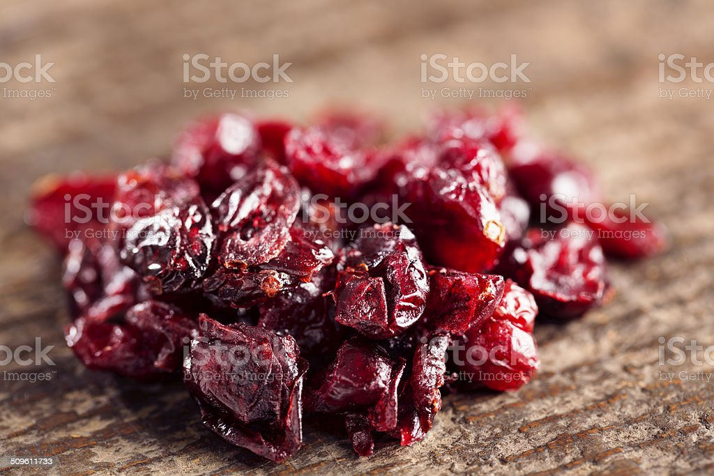 dried fruit: cranberries on wood stock photo