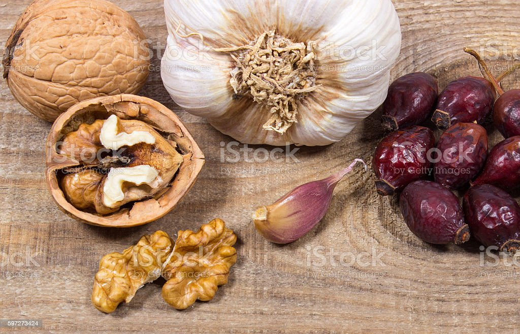 Dried fruit of hawthorn, garlic and walnuts. Alternative medicine. royalty-free stock photo