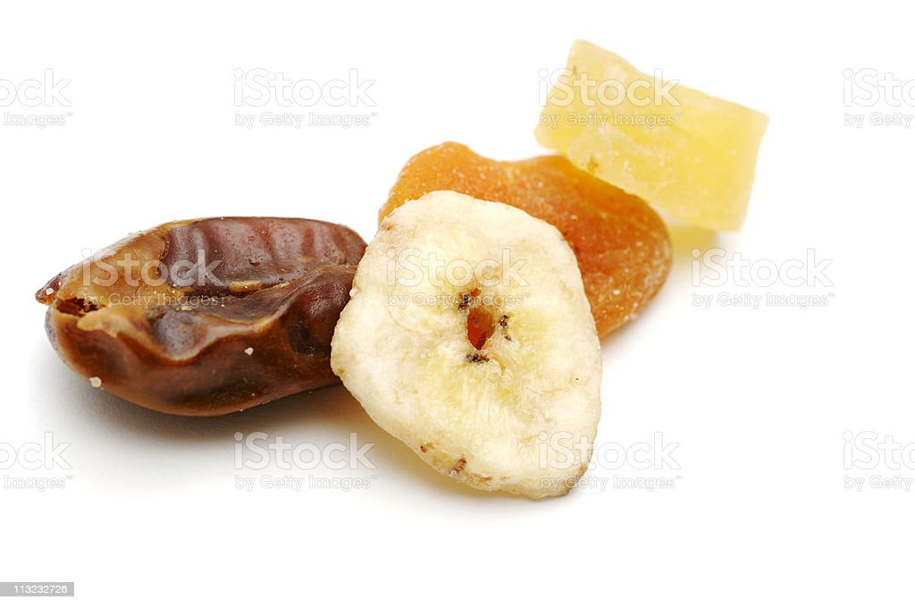 dried fruit pieces, healthly snack against white stock photo
