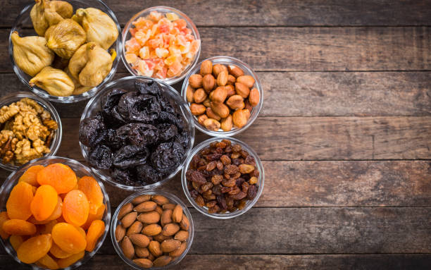 dried fruits and nuts in the bowl - dried fruit stock photos and pictures
