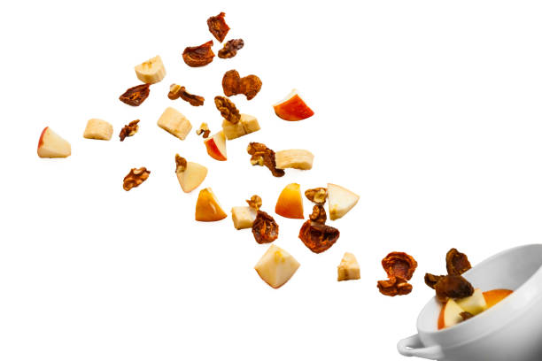dried fruits, apples, bananas and nuts to throw the air stock photo