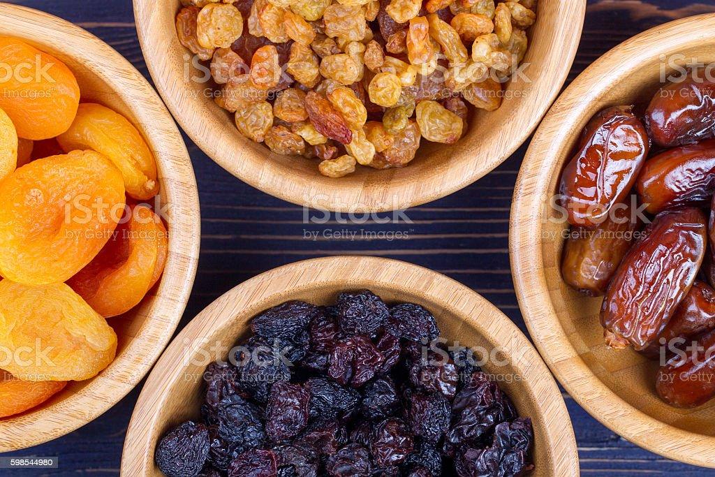 Dried fruits assortment on wooden background. Top view photo libre de droits