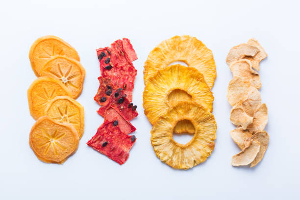 Dried fruits, dehydrated persimmon, watermelon, pineapple, apple chips stock photo