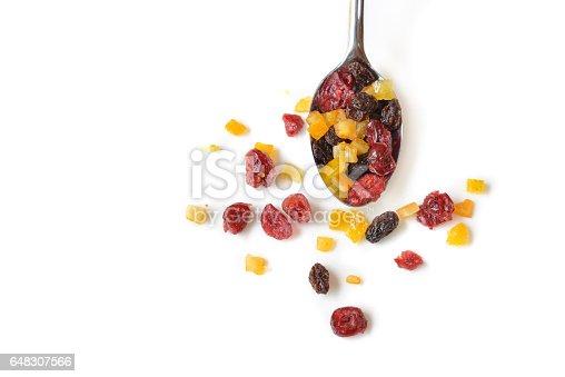 Dried fruits on white background - isolated (Cranberry, raisin and orange)