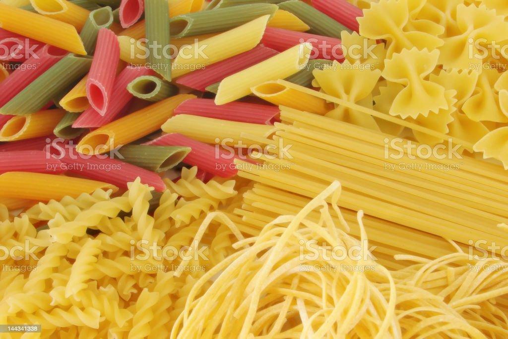 Dried fusilli spaghetti and taglettelli pasta stock photo