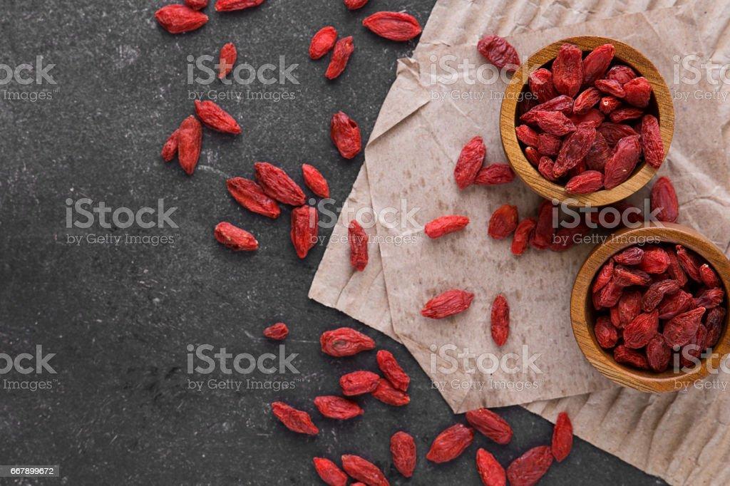 Dried Goji Berries on dark background, top view royalty-free stock photo