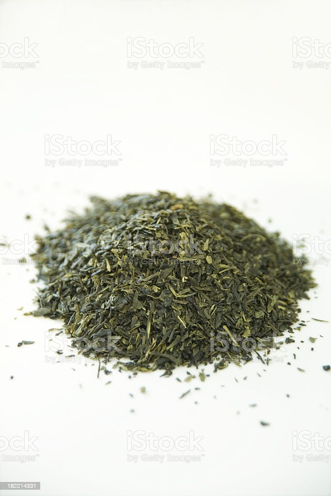 Dried green tea leaves isolated on white stock photo