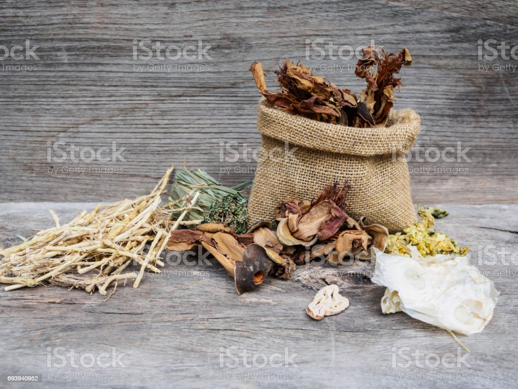 Dried herbal medicine  chinese on wooden background stock photo