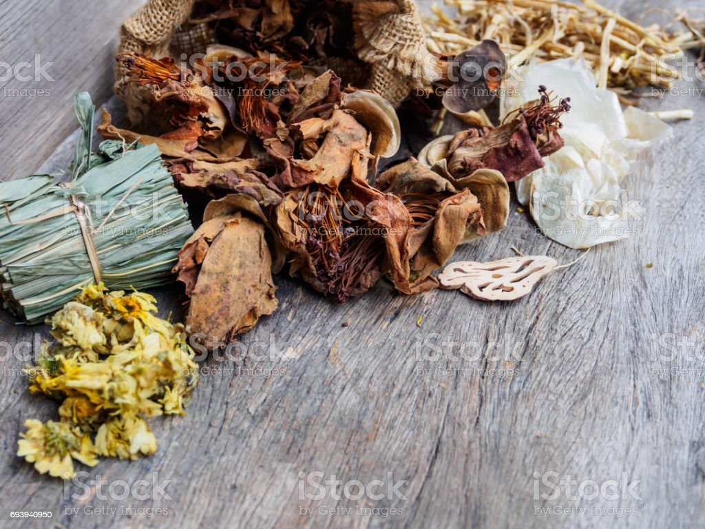 Dried herbal natural on rustic wooden background stock photo