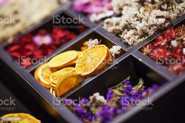 Photo of Dried Herbs and flowers in wooden box. Collage. Soft focus. Close up