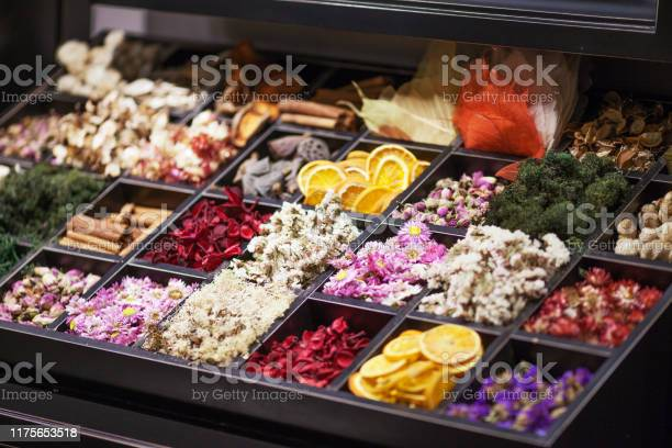 Photo of Dried Herbs and flowers in wooden box. Collage. Soft focus