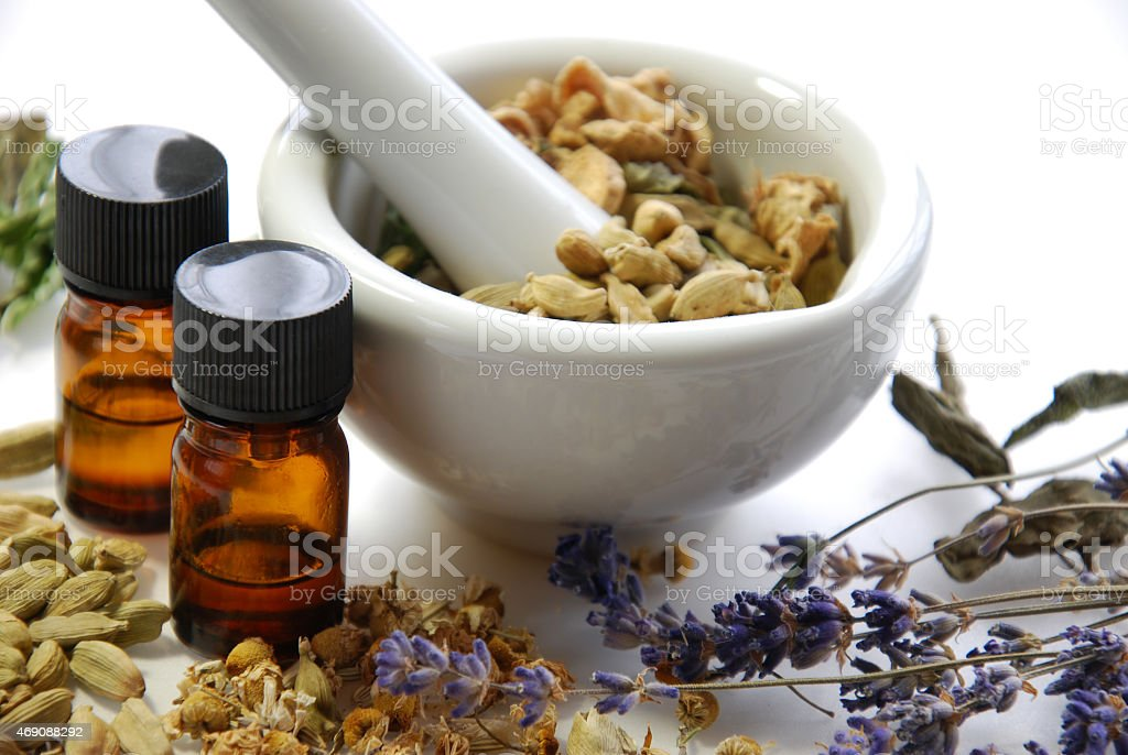 Dried herbs and flowers with a mortar and pestle  stock photo