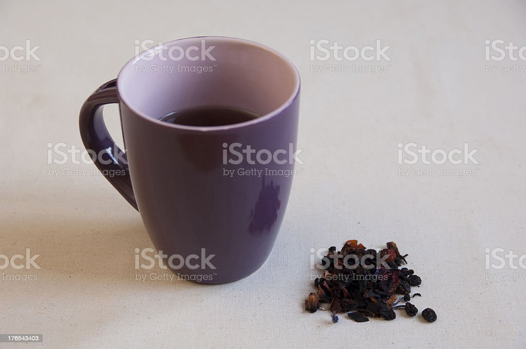 Dried Herbs, Fruits Preaparation in a bowl and Herbal Tea royalty-free stock photo