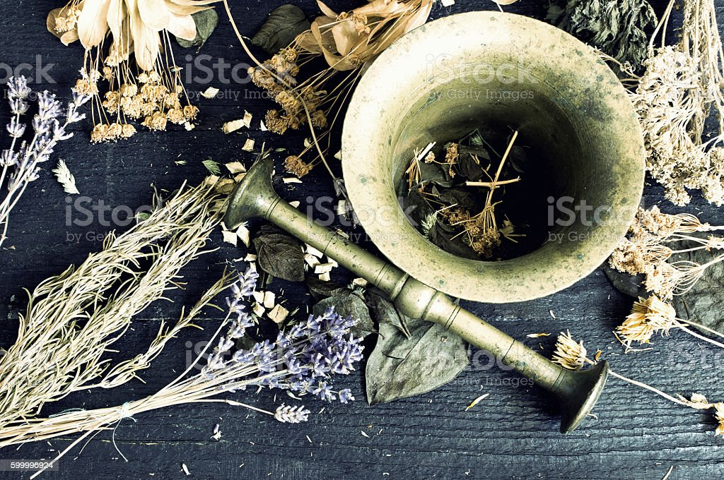 Dried herbs in a mortar stock photo