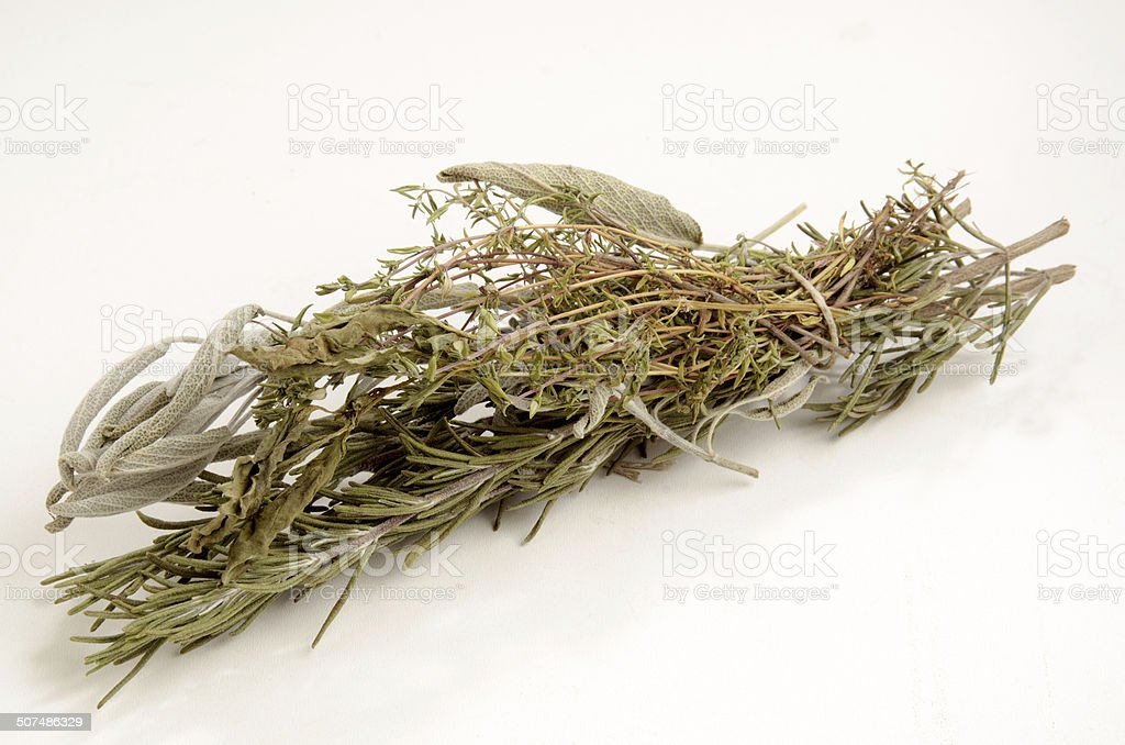 dried herbs on a light background stock photo
