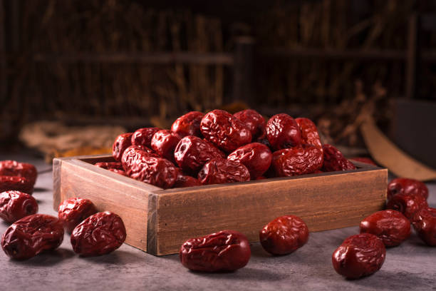 Dried jujube fruit on wooden table Dried jujube fruit on wooden table jujube candy stock pictures, royalty-free photos & images