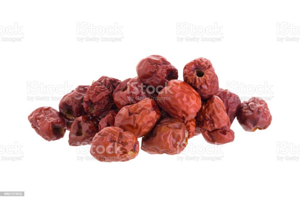 Dried jujube fruits chinese herbal medicine on a white background zbiór zdjęć royalty-free