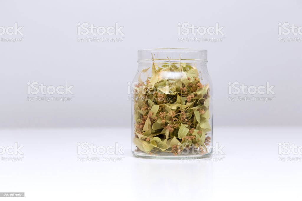 Dried lime leafs in a glass jar. stock photo