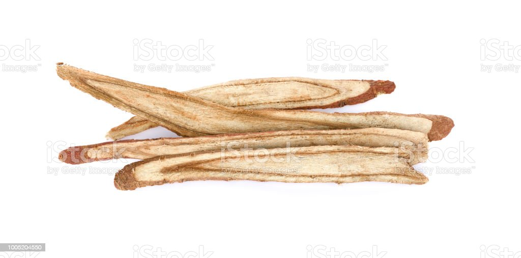 dried Liquorice roots on a white background. stock photo