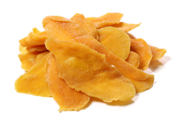 dried mango in a white background - dried food stock photos and pictures
