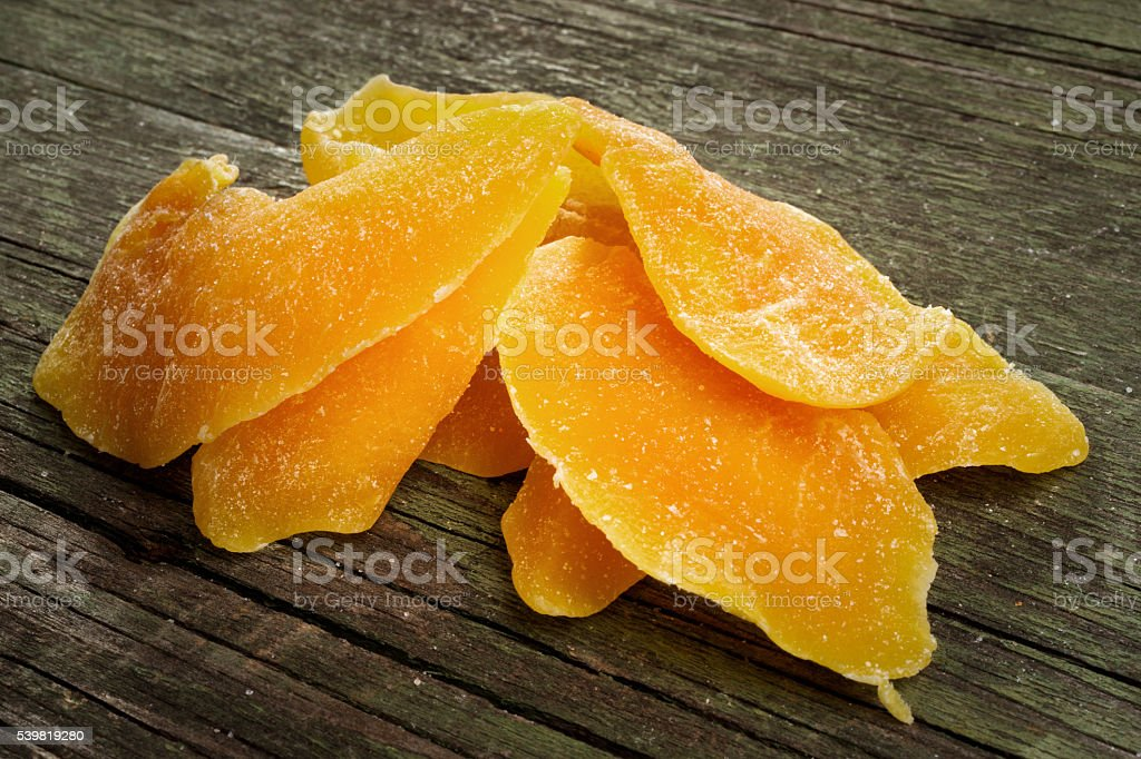 dried mango on wooden background stock photo