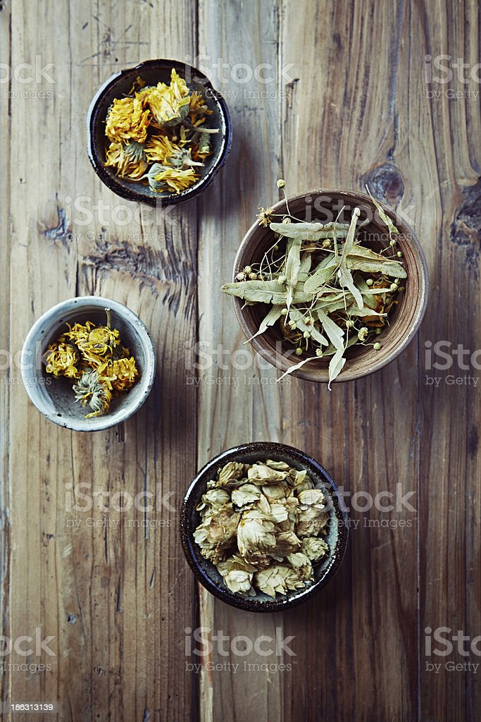 Dried marigold flowers, hops and linden blossoms stock photo