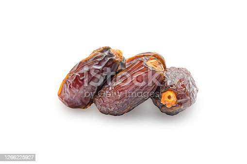 Dried Medjoul date fruit on white isolated background with clipping path. Dates palm is food for Ramadan or medjool month. Delicious dried fruit with juicy meaty sweet taste and have high fiber.