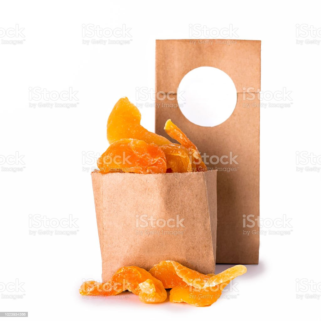 Dried melon in the craft package. Nuts and dried fruits in the craft...