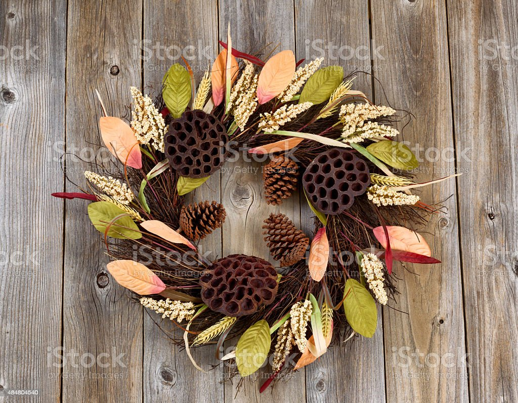 Dried nature wreath on rustic wooden boards stock photo