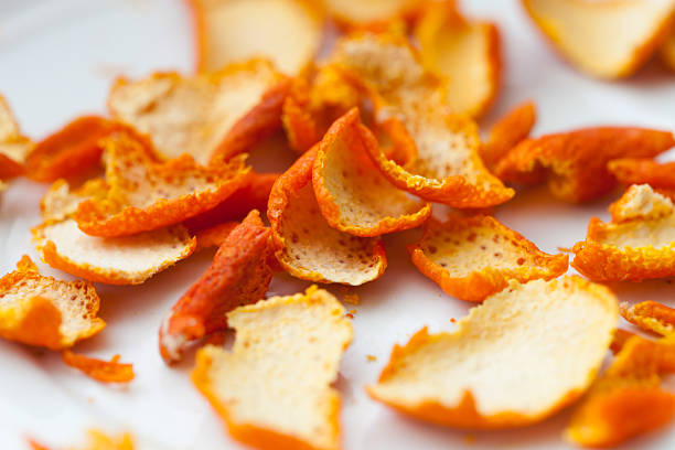 dried orange zests dried orange zests on white background peel plant part stock pictures, royalty-free photos & images