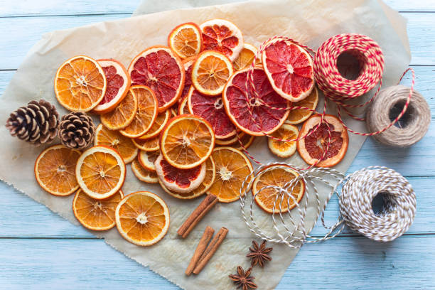 dried oranges and graprfruit for diy projects and zero waste Christmas decorations stock photo