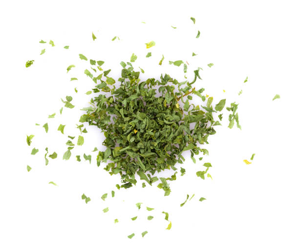 dried parsley isolated on white background - parsley stock photos and pictures