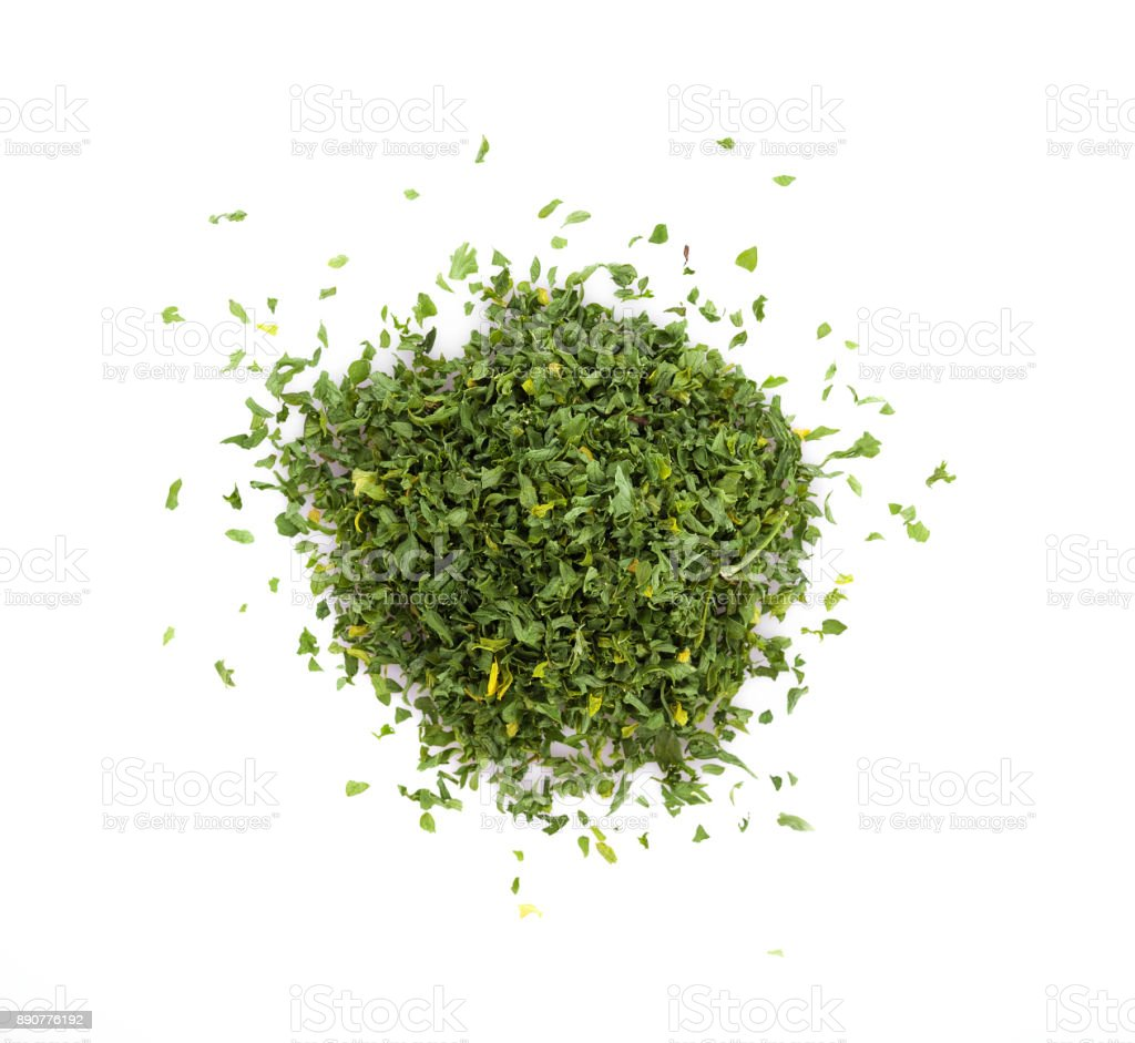 dried parsley isolated on white background stock photo
