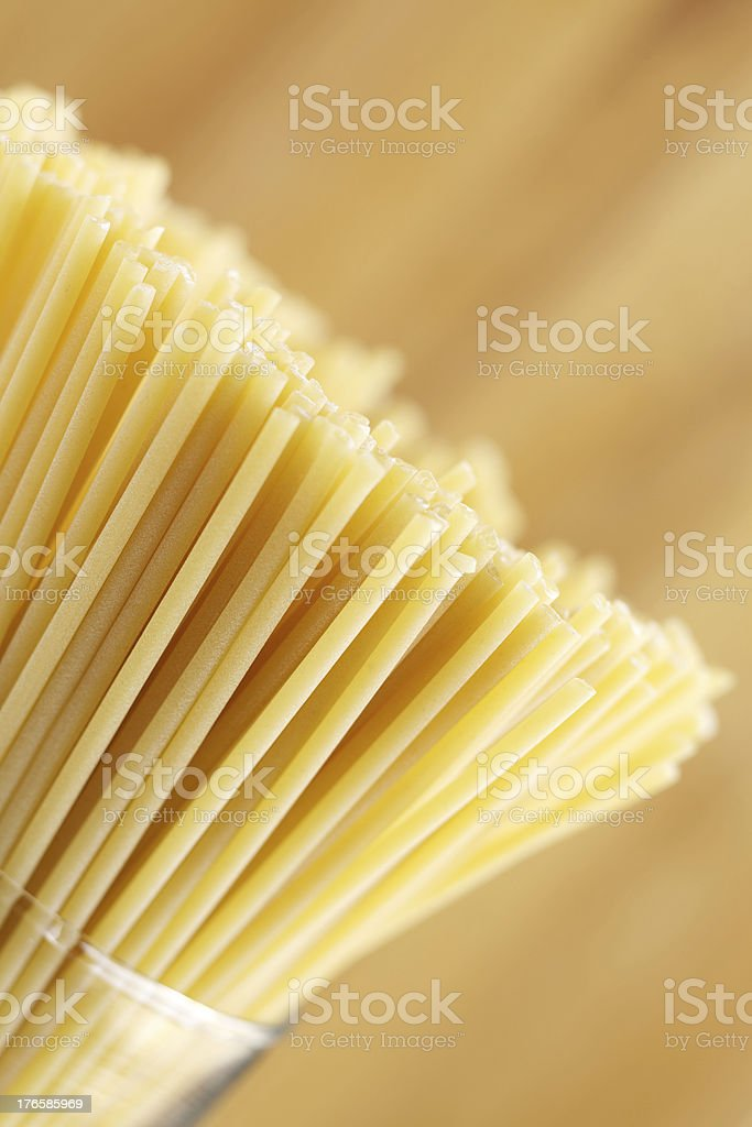 Dried pasta tubes in glass cylinder bowl royalty-free stock photo