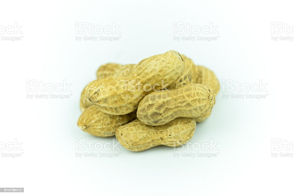 Dried peanuts isolated on white stock photo