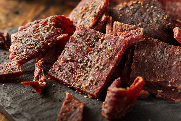 dried peppered beef jerky - beef stock pictures, royalty-free photos & images