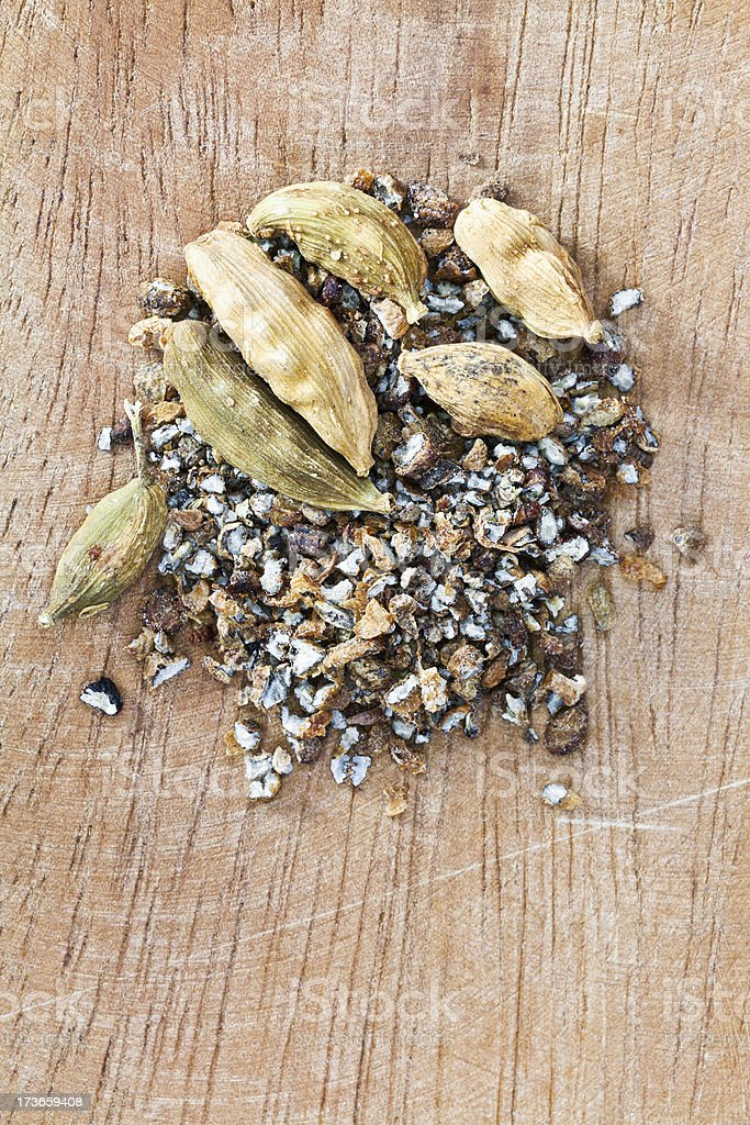 dried pods and freshly ground of cardamon royalty-free stock photo