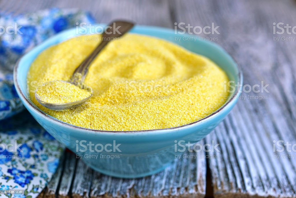 Dried polenta in a blue vintage bowl. stock photo